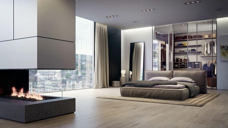 arredo moderno con armadio dietro letto