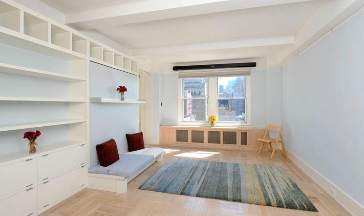 Salotto Con Parquet E Libreria A Muro Interior Design : Libreria in nicchia con mensole incassate a muro mobili