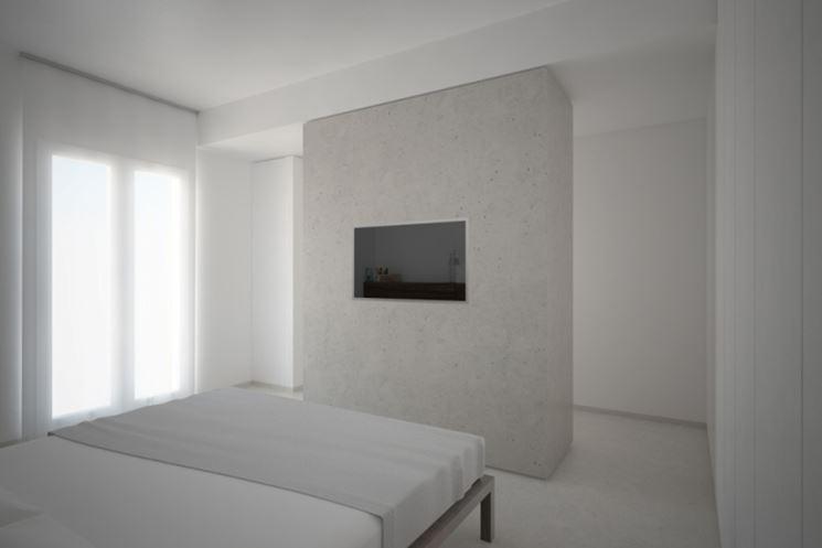 Camera con pilastro come ricavare una zona retroletto for Cabina armadio dietro il letto