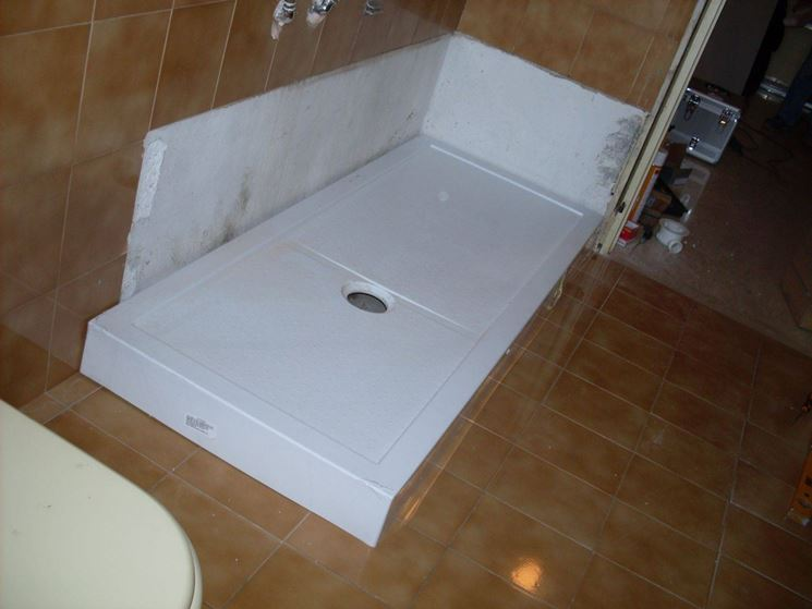 Installare un piatto doccia impianti idraulici - Bagno in muratura costi ...