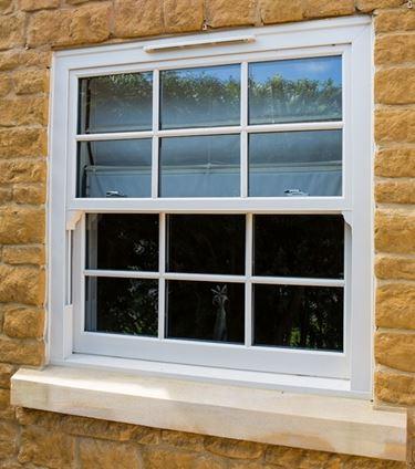 finestre scorrevoli verticali
